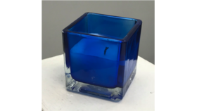 Image of a Blue Glass Square Votive with Wax