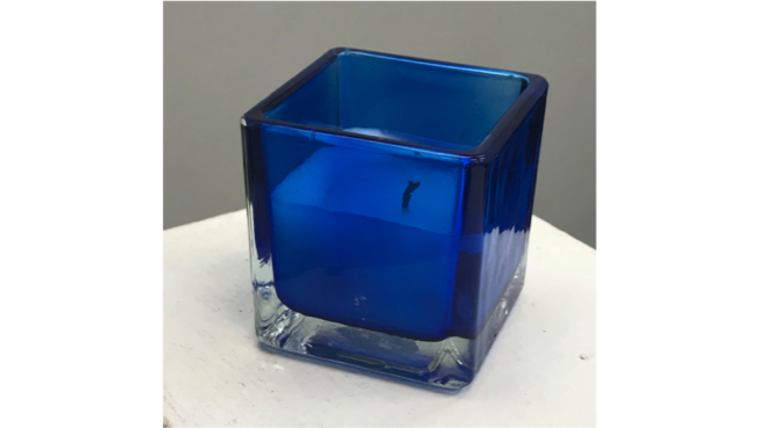 Picture of a Blue Glass Square Votive with Wax