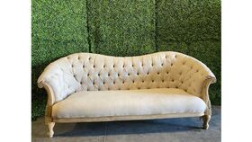 Image of a sofa - vintage tufted - ivory