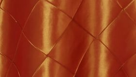 "Image of a 120"" Round Fire Orange Pintuck Tablecloths"
