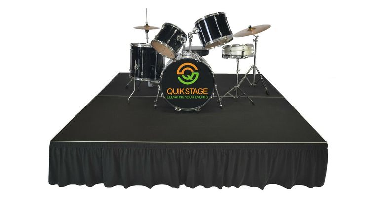 """Picture of a 12' x 12' x 24"""" Stage with Skirt and Stair Step"""