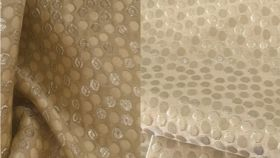 """Image of a 90"""" x 156""""  Champagne Confetti Tablecloths"""