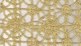 Image of a Gold Sequin Lace Runner