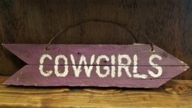 "Image of a ""Cowgirls"" Sign"