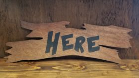 "Image of a ""Here"" Sign"