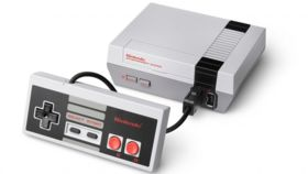 Image of a NES Classic Console with 2 controllers