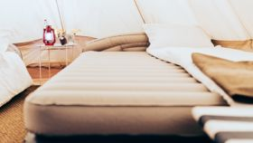 Image of a Queen Air Bed with Linens