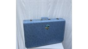 "Image of a blue ""Hong Kong"" suitcase"