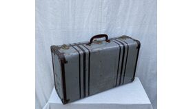Image of a grey metal suitcase
