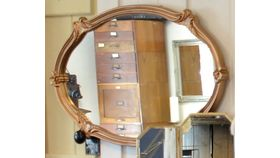 Image of a Copper Framed Oval Mirror