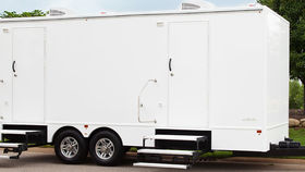 Image of a 8 Stall White Executive Restroom Trailer w/AC & Heat Rental
