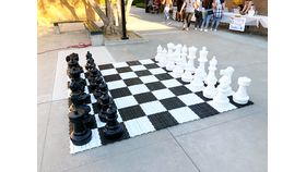 Image of a Giant Black & White Chess Set & Board Game Kit Rental