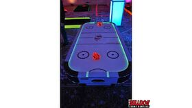 Image of a Glow in the Dark Air Hockey Game