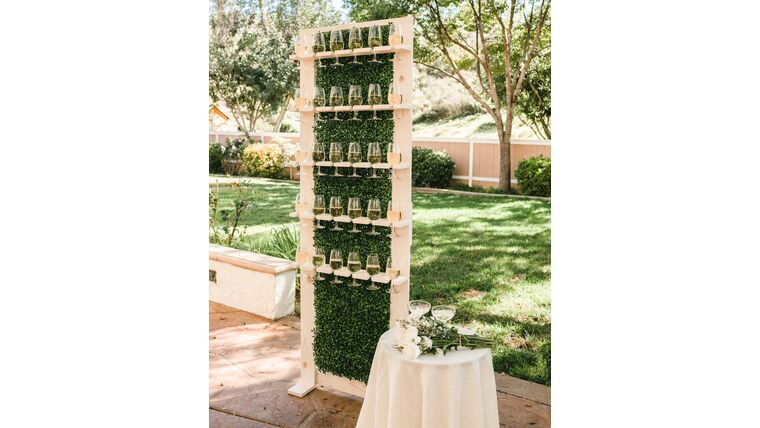 Picture of a 3' x 7' Wood & Greenery Wine/Champagne Wall