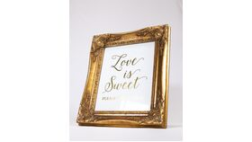 "Image of a ""Love is Sweet"" Sign - White/Gold/Ornate Gold Frame"