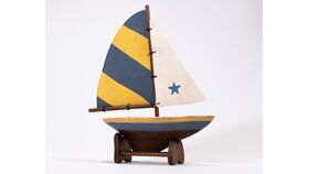 Image of a Wooden Sailboat with Stand