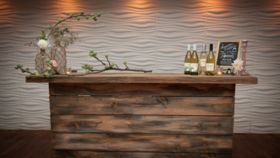 Image of a Rustic Farmwood Bar with Black Table