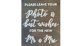 "Image of a Signage - ""Please leave your photo & best wishes for the new Mr. & Mrs."""