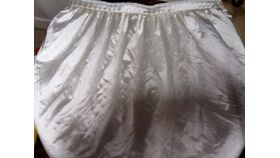 Image of a Ivory Ruffled Matte Satin 16' L x 3' H Table Skirt