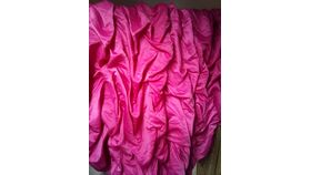 Image of a Fuscia Matte Satin Ruffled 19' L x 3' H Table Skirt