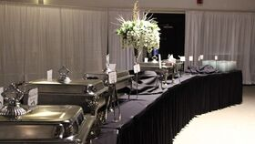 "Image of a Black Linen 16'  L x 30"" H Table Skirt"