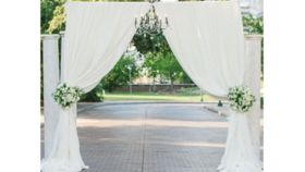 Image of a 07 - Pipe & Drape 2 Post Arch with White Sheer Draping Tieback Outdoor