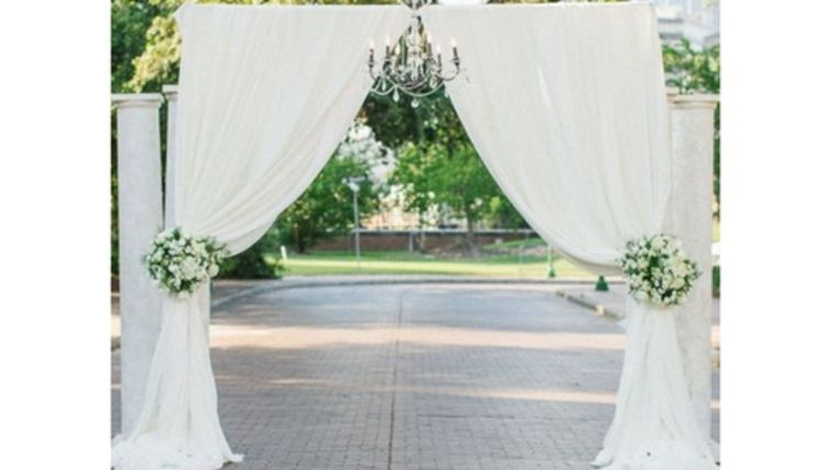 Picture of a 07 - Pipe & Drape 2 Post Arch with White Sheer Draping Tieback Indoor