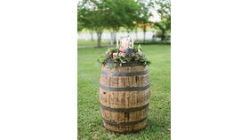 Image of a Whiskey Barrel with Floral Topper