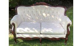 Image of a Vintage Ivory Sofa