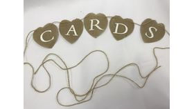 Image of a Burlap Cards Sign on String