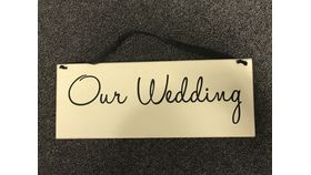 "Image of a ""Our Wedding"" Sign"