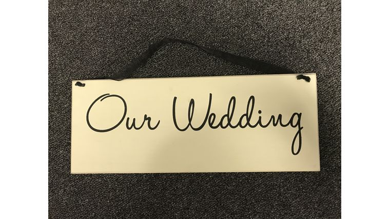 "Picture of a ""Our Wedding"" Sign"