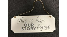 "Image of a ""This is How Our Story Begins"" Sign"