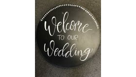 "Image of a ""Welcome to Our Wedding"" Circle Sign"