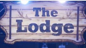 "Image of a Sign-""The Lodge"""