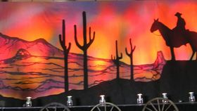 Image of a Backdrop-Western Sunset Cowboy & Cactus Canvas