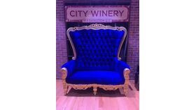 Image of a Royal blue w/gold trim love seat
