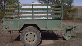 """Image of a 525 Gallon Water Tank on Army Trailer incl. water (2"""" ball)"""