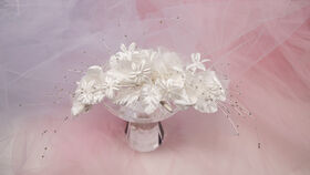 Image of a Bridal hair acccessories , Head piece, flowers with bows and beads