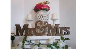 "Image of a "" Mr. & Mrs."" wooden sign brown 23.3 x 7"""