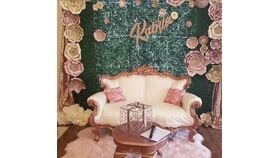 Image of a 8 x 8 Faux Boxwood Backdrop on frame with Pole Covers
