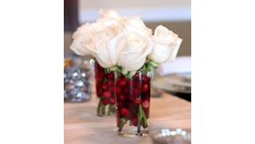 Image of a Christmas White Rose/Cranberries Arrangement Set