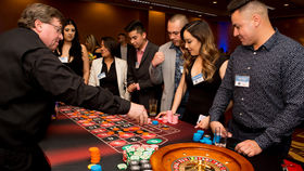 Image of a Roulette Table (Standing), Fully Equipped with Dealer