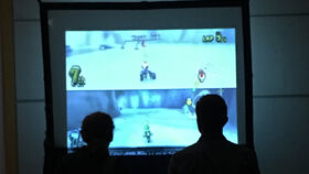 Image of a Xbox/Wii w/ Giant Screens