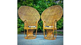 Image of a Boho Vintage Rattan Peacock Chairs (Set of 2)