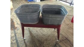 Image of a Double Galvanized Drink Tub With Red Stand