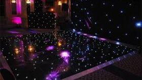 Image of a Gloss Black LED Star Vinyl Dance Floor Section Rental - 4' x 4'