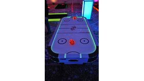 Image of a Air Hockey - 2 Player Glow In The Dark/UV Air Hockey Game Kit