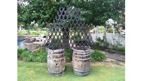 Image of a Black Metal Horse Shoe Wine Rack