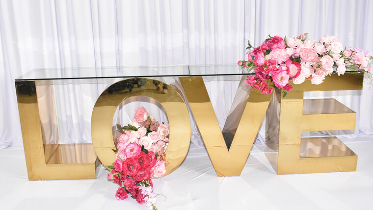 Picture of a LOVE GOLD STAINLESS STEEL DISPLAY LETTER TABLE